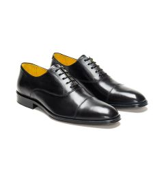 A custom made cap toe leather oxford shoe, black with black laces and black stitching. (Side 2 View)