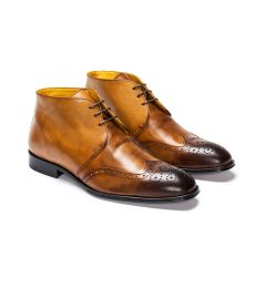 A custom made brogue leather chukka boot, camel patina with dark brown laces. (Side View)
