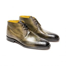 A custom made brogue leather chukka boot, green patina with black laces and green stitching. (Side 2 View)