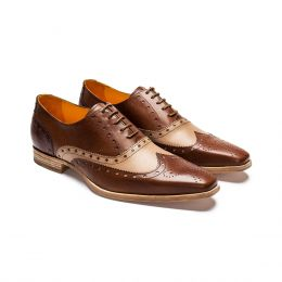 A custom made brogue leather oxford shoe in brown and sand coloured calfskin leather.  (Side View)