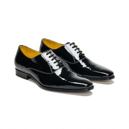 A custom made leather oxford shoe, black with black laces and grey stitching. (Side 2 View)