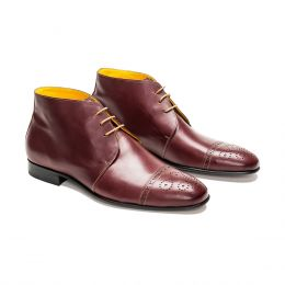 A custom made half brogue leather chukka boot, burgundy with beige laces and beige stitching. (Side 2 View)