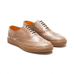 A custom made brogue leather oxford sneaker, sand with brown laces and brown stitching. (Side 2 View)