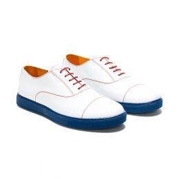 A custom made cap toe leather oxford sneaker, white with red laces and red stitching. (Side 2 View)
