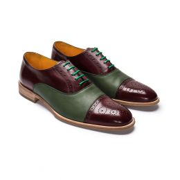 A custom made brogue leather oxford shoe in burgundy  and green Calf Leather, finished with green laces and stitching.(Side View)
