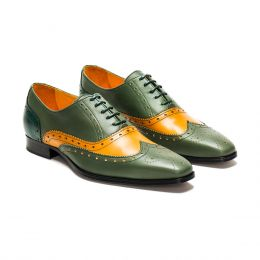 A custom made brogue leather oxford shoe, green and cognac with green laces and green stitching. (Side 2 View)