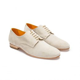 A custom made derby shoe in white suede.(Side View)
