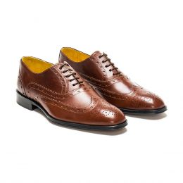 A custom made brogue leather oxford shoe, brown with brown laces and brown stitching. (Side 2 View)