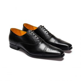 A custom made leather half brogue oxford. Bespoke handmade with black Calf Leather. (Side View)