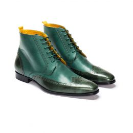A Custom made Brogue Leather Stand. Boot, Green with dark green laces and stitching. (Side View)