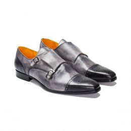 A custom made monk strap grey shoe with grey stitching. (Side View)