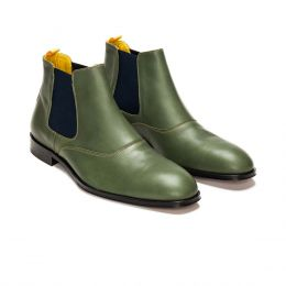 A Custom made leather chelsea boot, green with blue elastic and beige stitching. (Side 2 View)