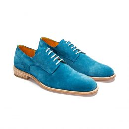 A Custom made wholecut leather derby shoe, with blue stitching. (Side View)