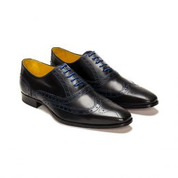 A Custom made brogue leather oxford shoe, black with blue laces and blue stitching. (Side 2 View)