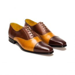 A Custom made cap toe leather oxford shoe, cognac and chocolate with brown laces and brown stitching. (Side 2 View)