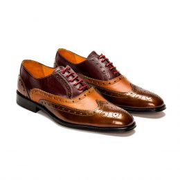 A custom made brogue leather oxford shoe, brown with red laces and beige stitching. (Side 2 View)
