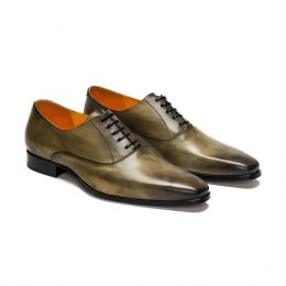 A custom made leather oxford shoes, green patina with black laces and black stitching. (Side 2 View)