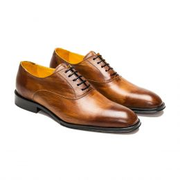 A custom made leather oxford shoe, brown patina with black laces and brown stitching. (Side 2 View)