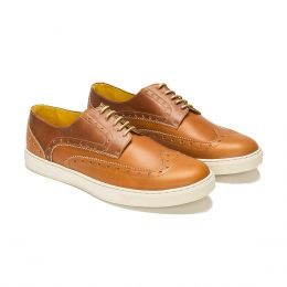 A custom made brogue leather derby shoe, brown with brown stitching and brown laces. (Side 2 View)